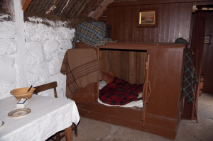 Interior with box bed of the Highland Cottage at the Highland Folk Museum, Newtonmore, Scotland
