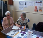 Marion Yool, local volunteer speaking to a local resident at the Cluny Primary School Then and Now Event