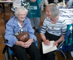 Marion Yool, local volunteer speaking to 98 yr old Lena from Rothes at the Cluny Primary School Then and Now Event