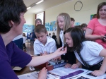 The school children trying to guess the smells at Cluny Primary School Then and Now Event