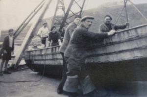 Cobble boat with Tom Howe with his hat at a jaunty angle