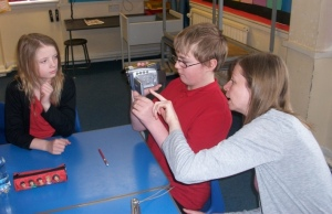One of the children in P7 learning how to use the film camera